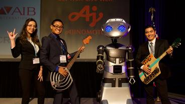 "Breanna Barragan, Steven Pham, and Eric Kinjo pose as ""rock stars"" with guitars after winning the American Society of Baking's annual Product Development Competition."