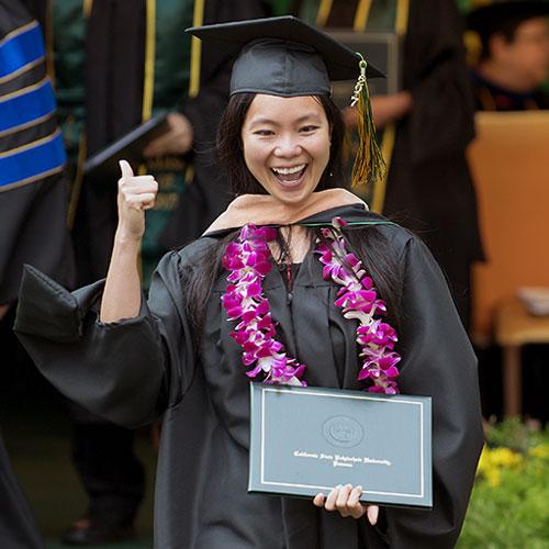 graduate celebrates during commencement