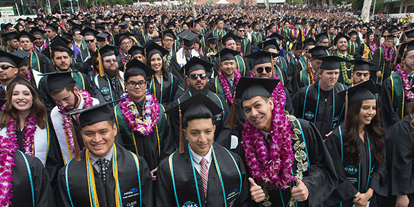 Students dressed in gowns at Commencement
