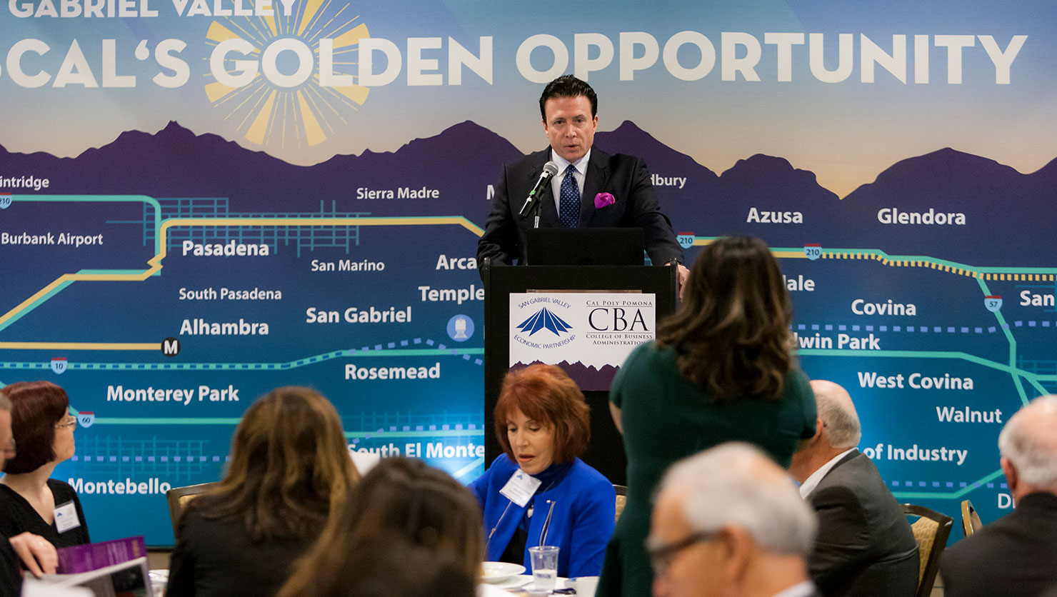 Keynote speaker in loose audience shot during 2018 SGV Economic Forecast Summit on March 15
