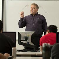 Pike teaching students