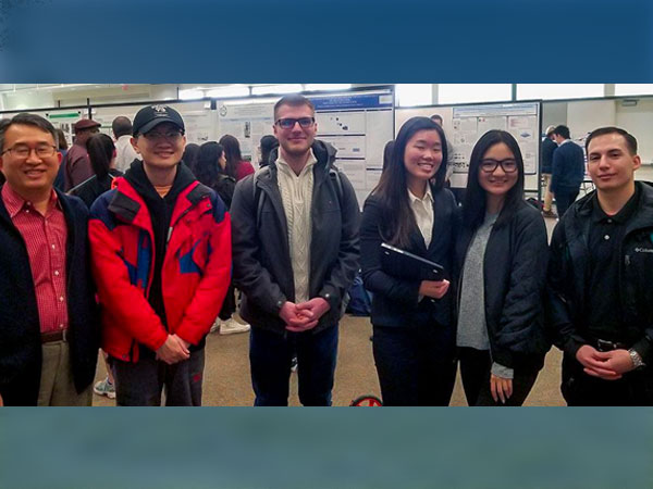 Jane Kim and Maverick Siragusa with professor and friends during the 2019 Research Competition