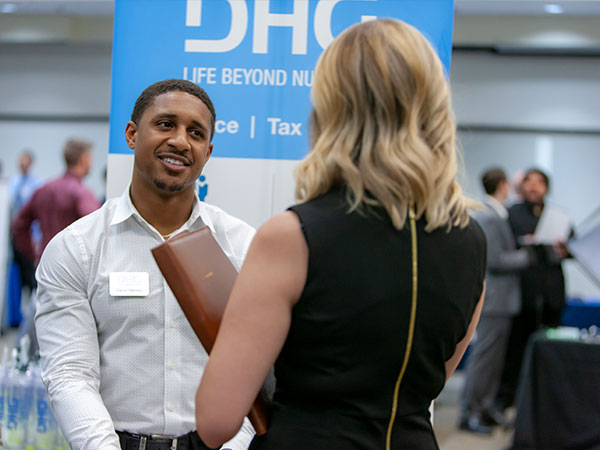 Recruiter talking to female student during career fair