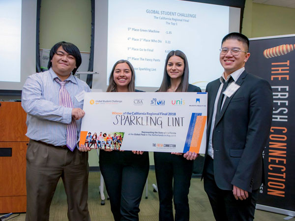 Four member of Sparkling Lint holding winning check