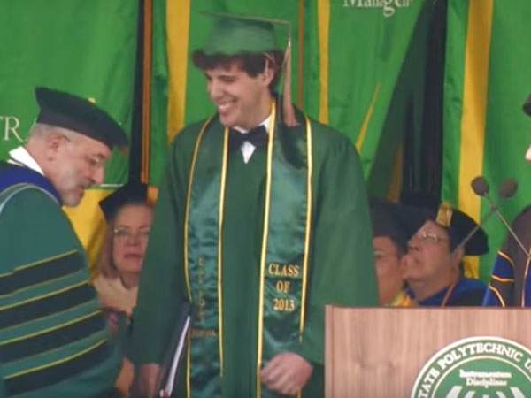 Roy Rosell receiving McPhee medallion at 2013 Commencement