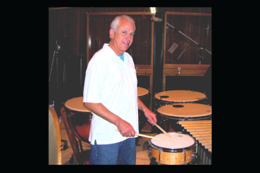 Dan Greco playing drums and percussions