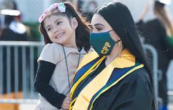 CPP graduate Rosalia Armas holds daughter Lillian