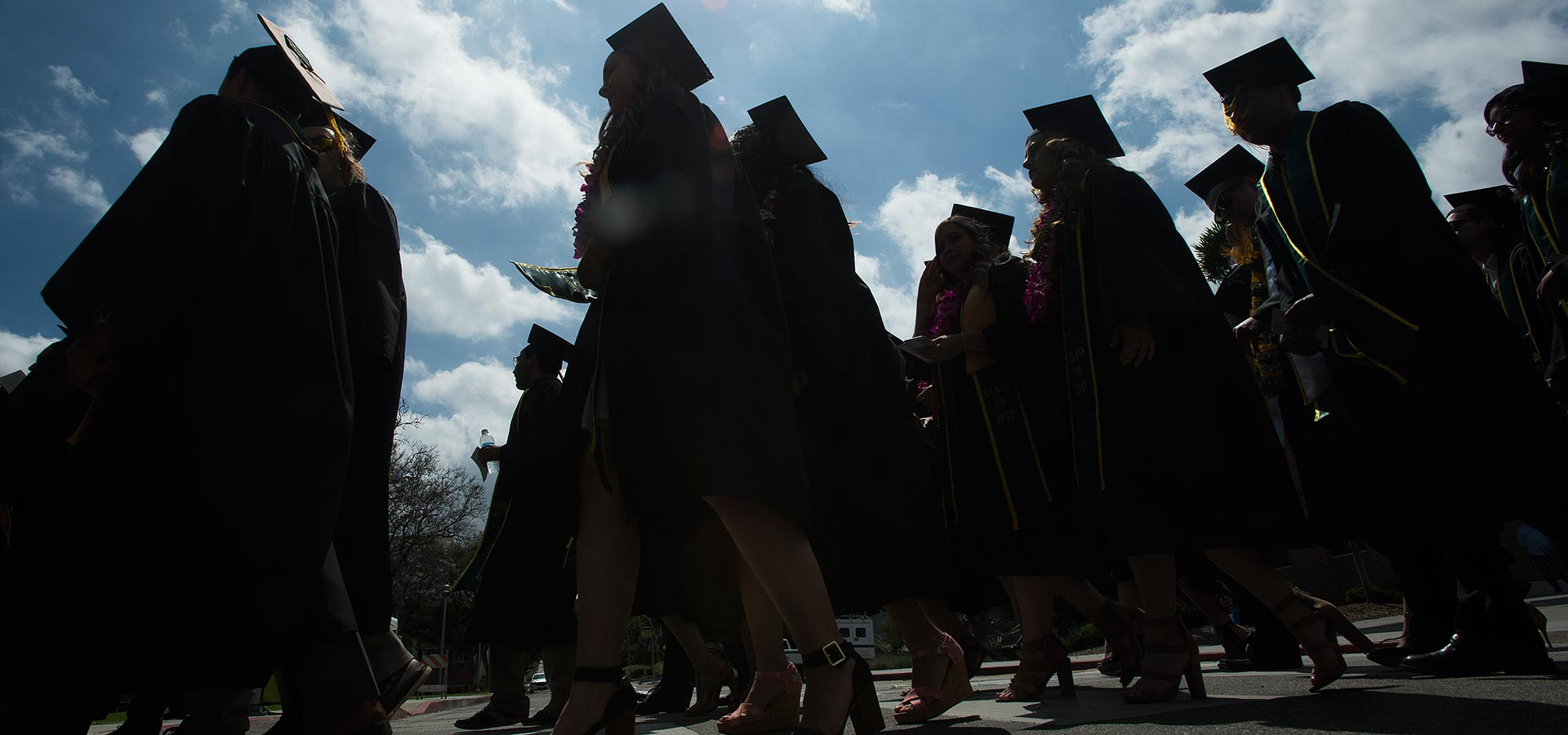 Silhouette of Students Walking during Commencement