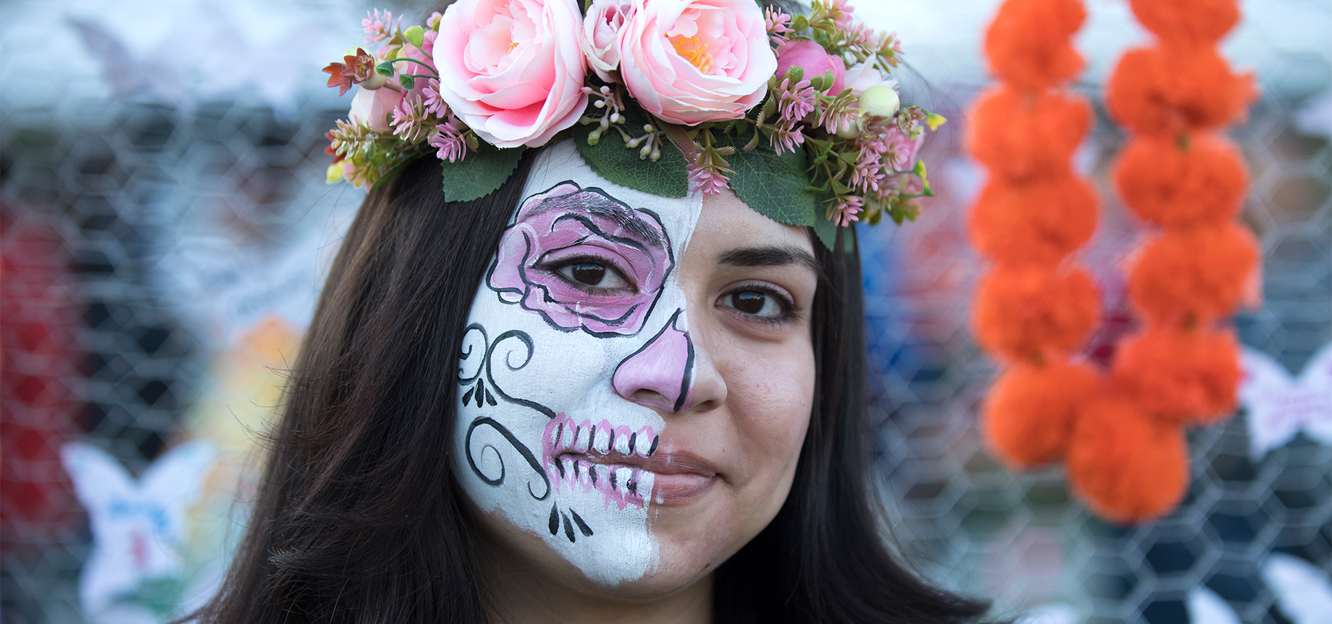 Student with skull makeup on Dia de los Muertos