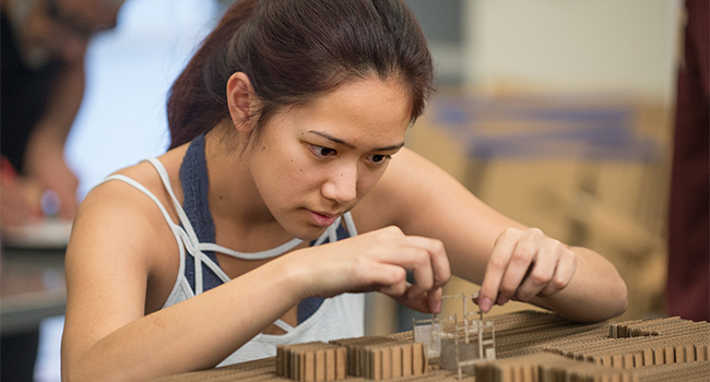 Anne Jao works on her model in her Architecture 103 class in the Interim Design Center