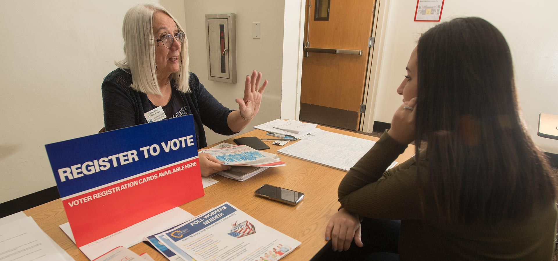 Cindy Rheaul  of the League of Women Voters speaks to a student