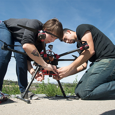 Students work on a drone at Spadra Farm