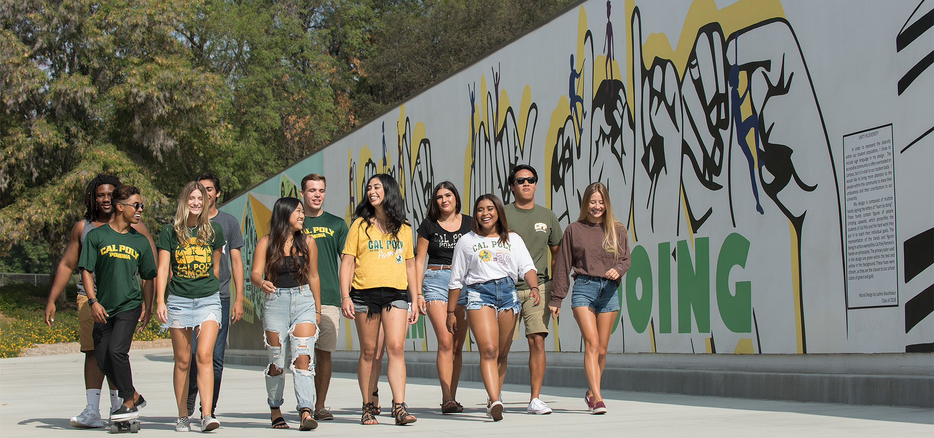 Students walking in front of the Parking Structure II Mural