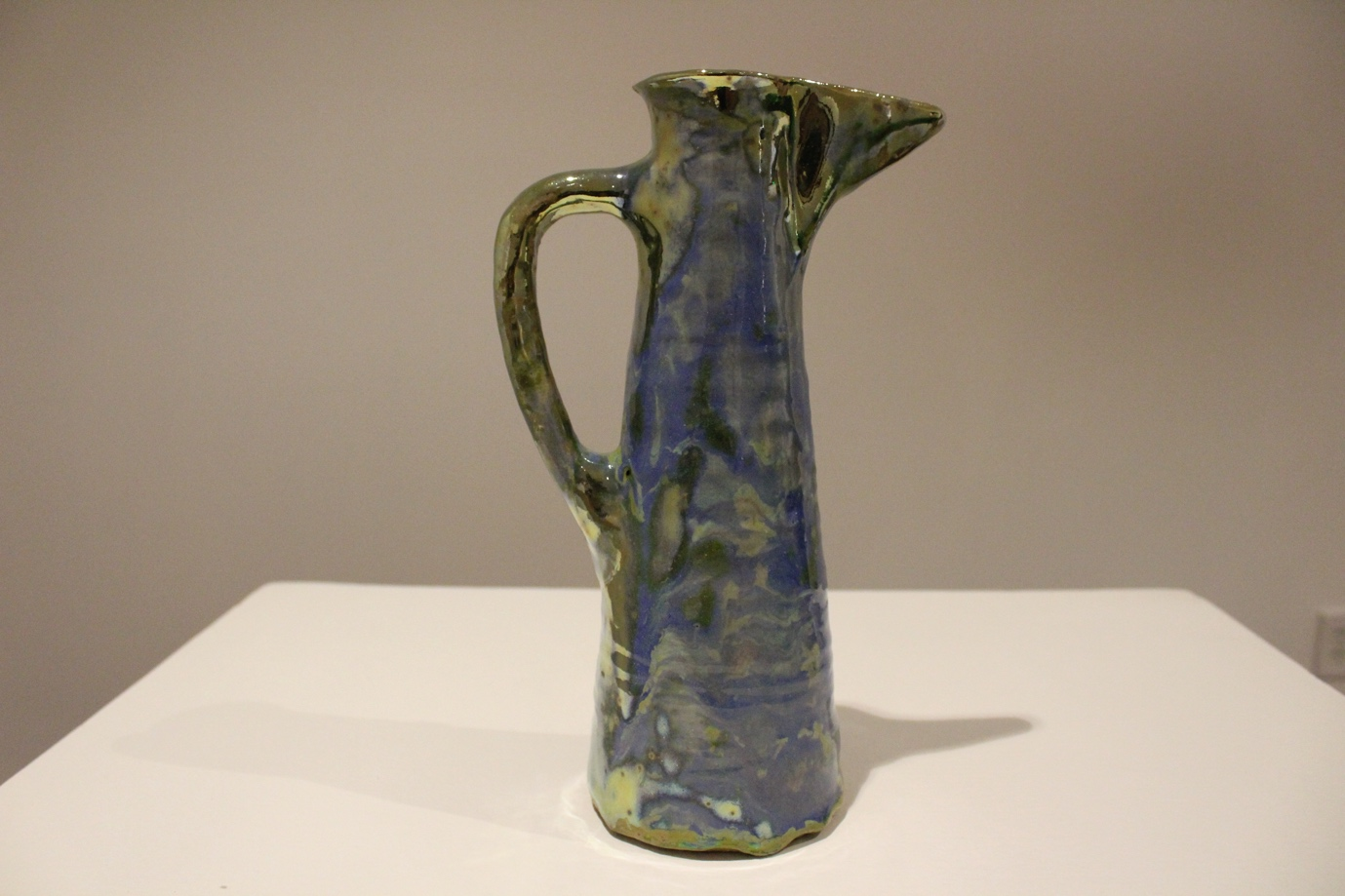 Pitcher, Cylindrical-form, with Wide Pouring Spout, Cerulean Blue-to-Greenish-Gold Glossy Surface piece.  navigate down for further details