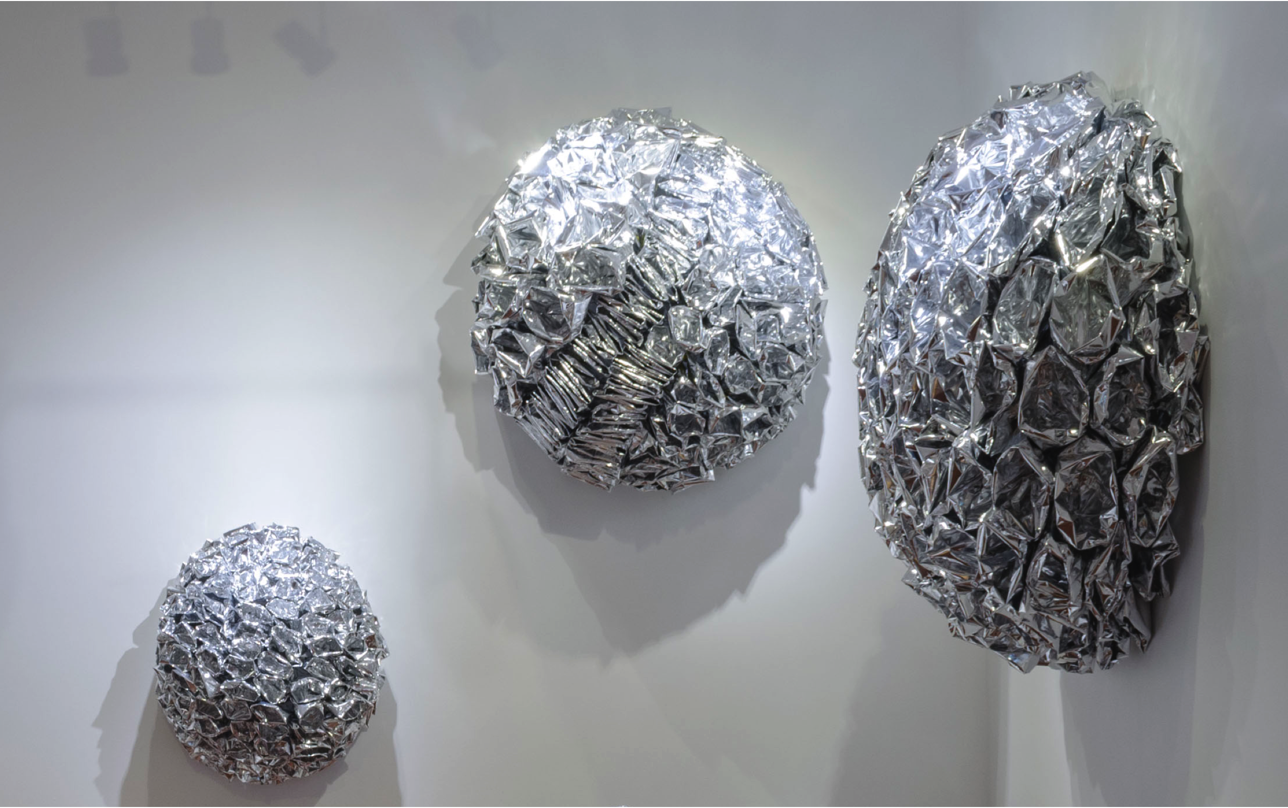 David Jang's Novelty piece made of chicken wire covered in inverted chip bags. Set of 3 in variable sizes.  navigate down for further details
