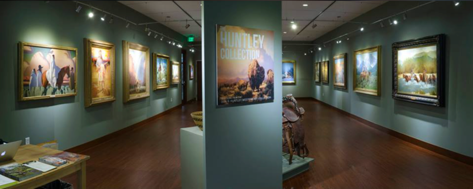 """Photo of the Huntley Collection, installation view of """"Life in the Wild West: Selections from the Don B. Huntley Western Art Collection"""" in 2015."""