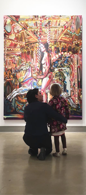 Young visitor engaged in Rebecca Campbell.  navigate down for further details