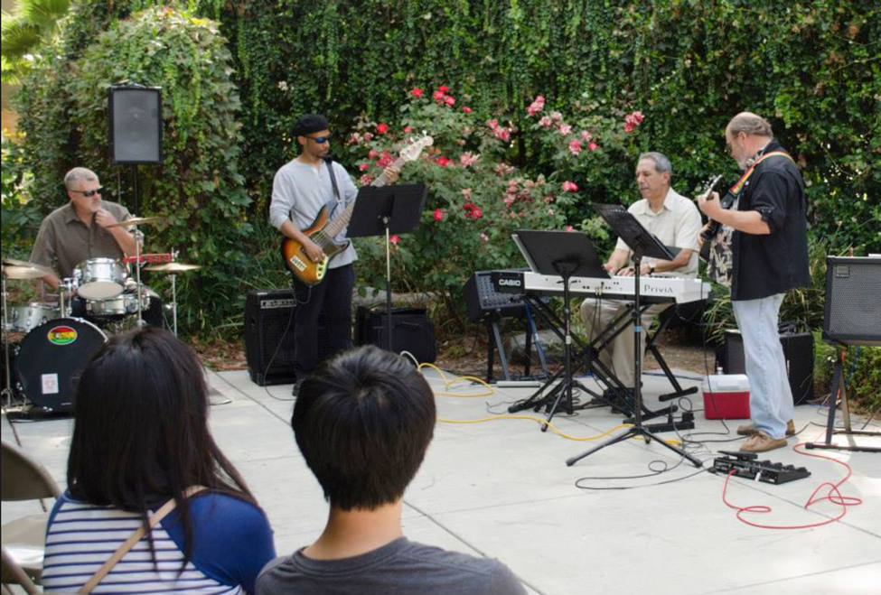 Gallery Courtyard Special Event with musical performance by friend of the galleries, Robert Grajeda, and his band in 2014.