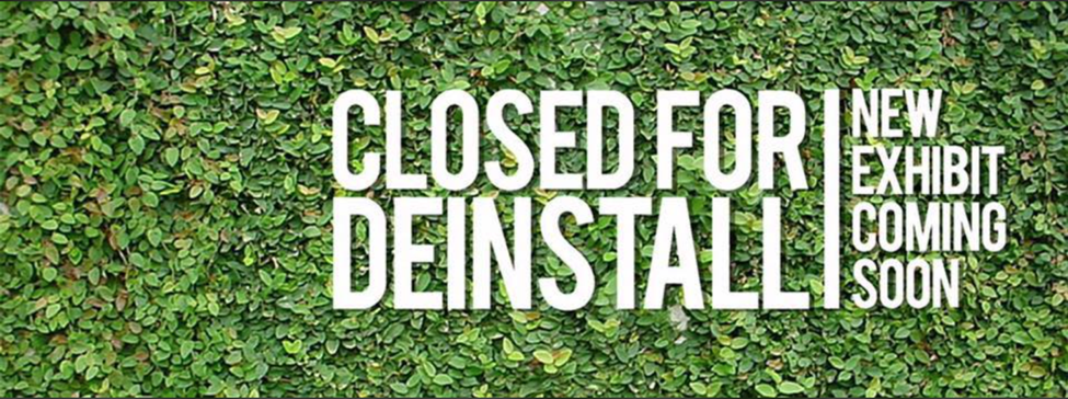 Closed for deinstall graphic with green vine covered brackdrop. New exhibit coming soon