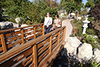 Two women crossing the Japanese Garden bridge
