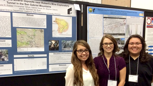 Students Brittany Curry, Taylor Robles and Nahtaly Pastrana stand in front of poster presentations at the conference.