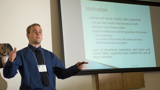 Student presenting research at competition