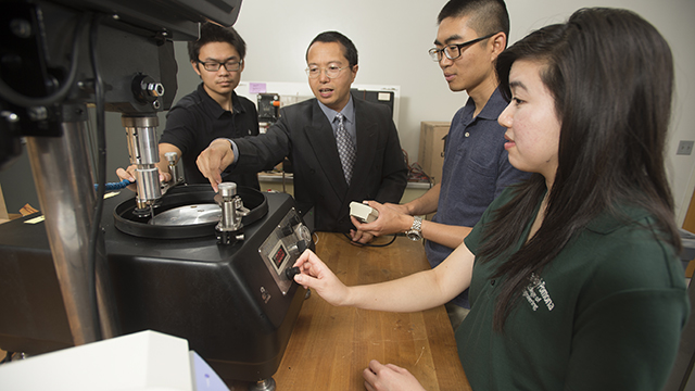 Mechanical Engineering Professor Yong Gan with students in his lab.