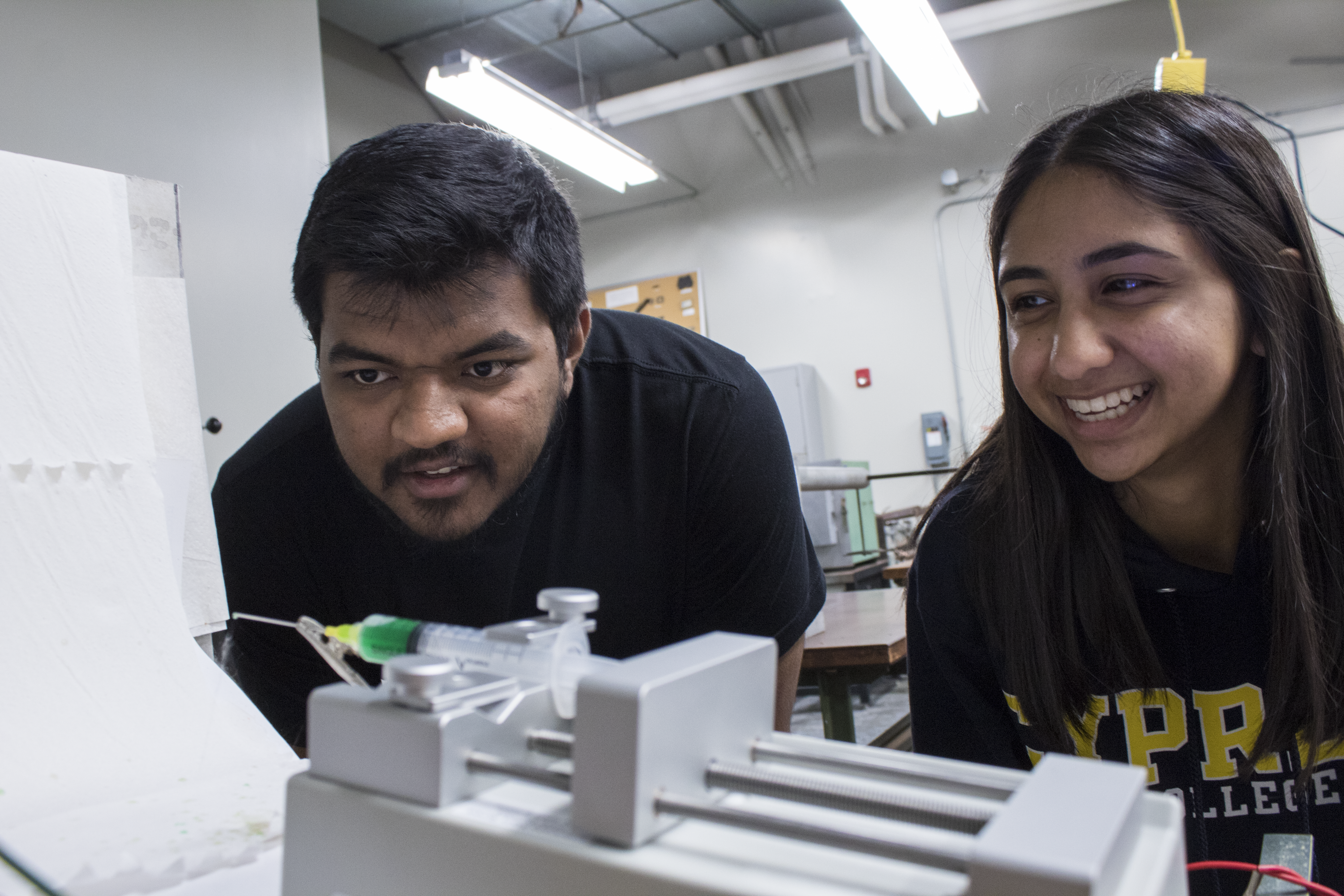 Student and mentor in lab setting