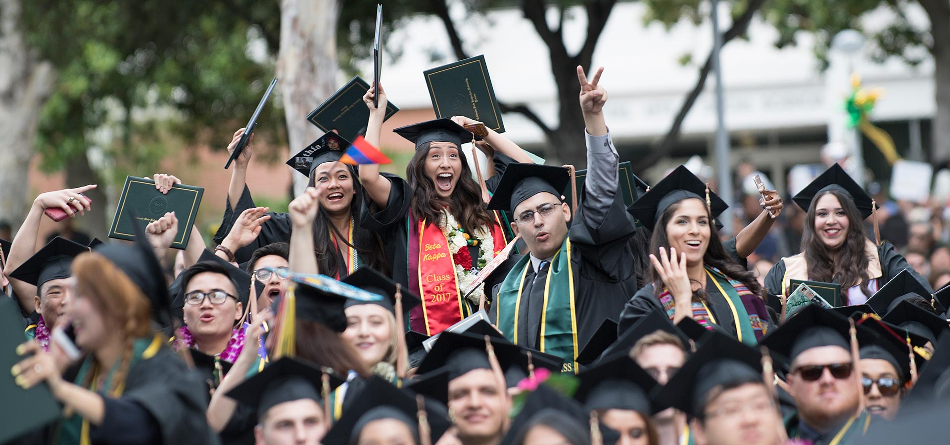 Students celebrating during a commencement ceremony at CPP