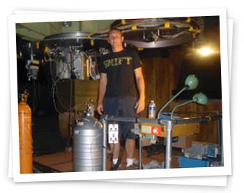 "Me standing by the 90"" Bok Telecope, in the process of refilling the FSPEC Dewar with liquid nitrogen."