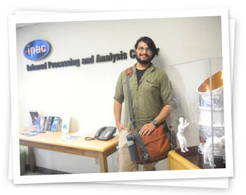 Mario standing in the entrance of ipac at Caltech.