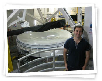 Remington standing in front of the primary 6.5-m LSST