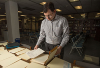 Rob Strauss, a project archivist, was hired in October as part of a federal grant the University Library's Special Collections and Archives received for a project that involves processing close to 600 boxes or archival materials.