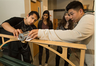 Students make stress readings in their Civil Engineering Lab.